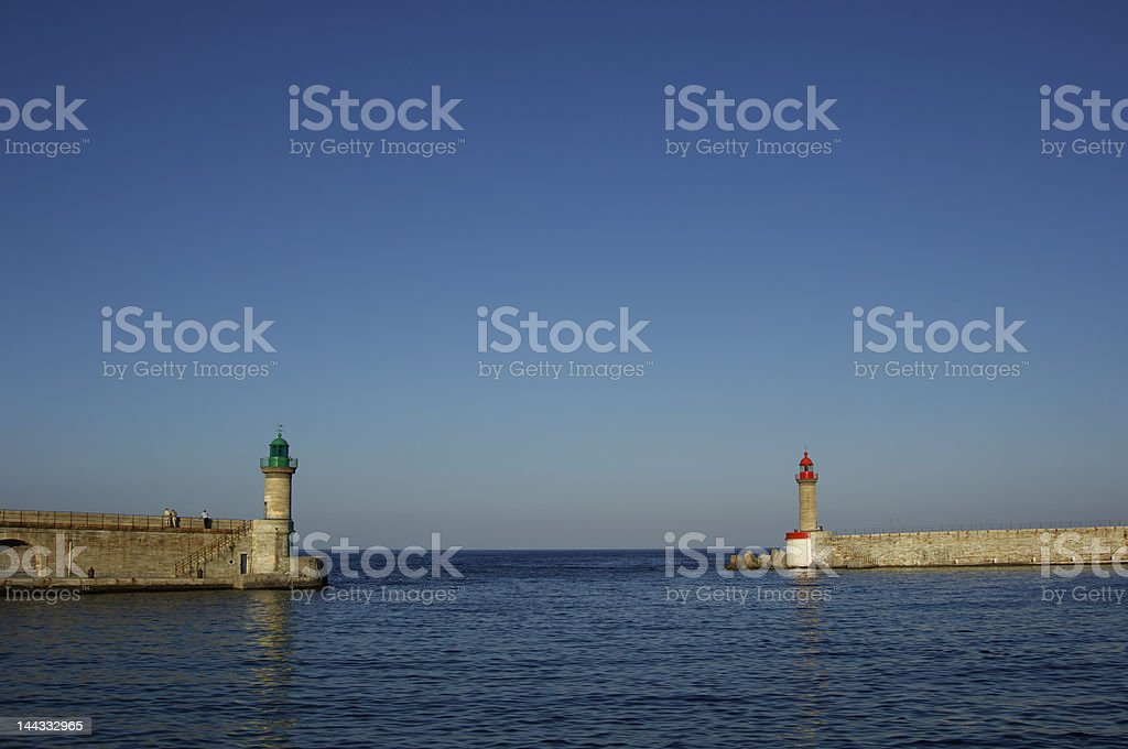 two beacon in the harbour royalty-free stock photo