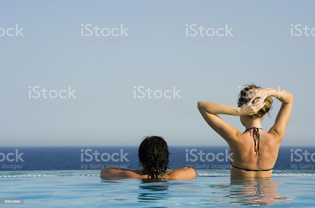 Two beauties in pool royalty-free stock photo