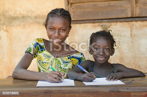 istock Two Beautiful African School Girls - Education for Africa Symbol 525318903