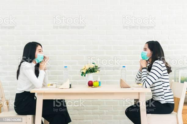 Two beautiful asian women are sitting and eating apart social new picture id1239245066?b=1&k=6&m=1239245066&s=612x612&h= y8l3z1a2ddbm9klyqsstv4krffvdji9mtvlrzommvo=