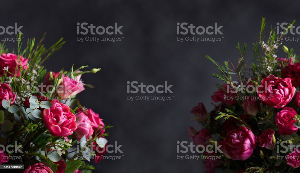 Two beautiful bouquet with red roses and peonies on a dark background. royalty-free stock photo