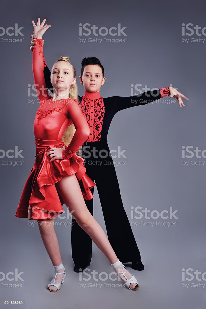 Two beautiful children dancing ballroom dance sport stock photo