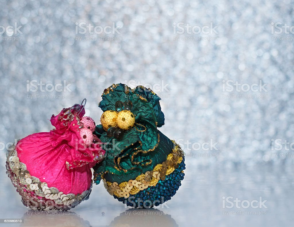 Two beautiful christmas toy on the bokeh background. foto royalty-free