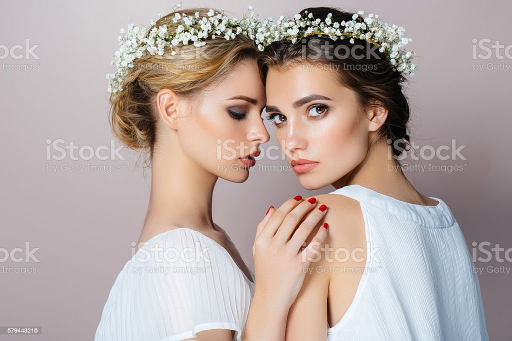 Two beautiful girls at the studio stock photo