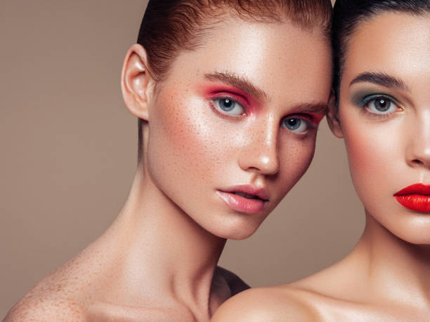 Two beautiful girls with make-up stock photo