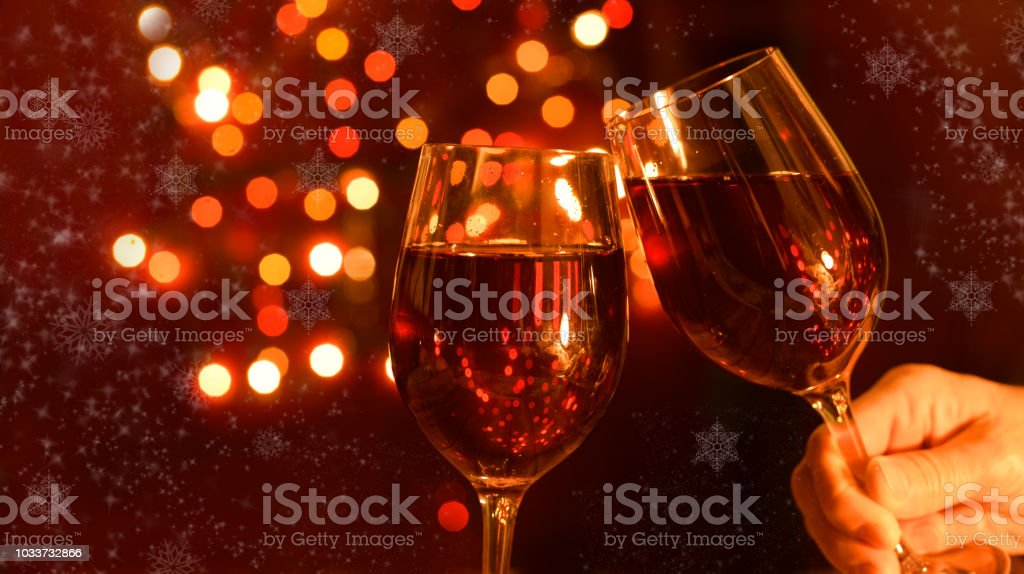 two beautiful glasses of a postcard with a drink of champagne red wine on a winter holiday in December new year stock photo