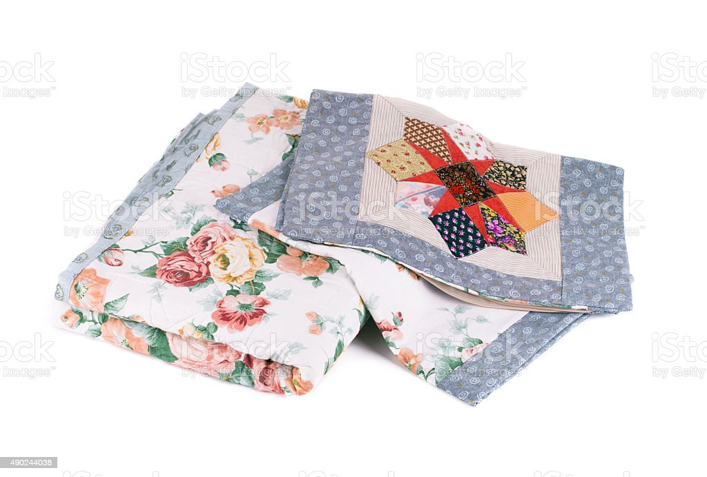 Two beautiful handmade quilts. stock photo