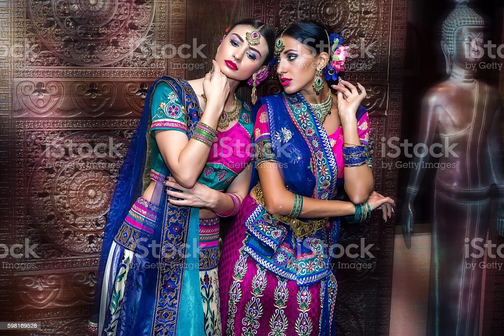 Two beautiful harem girls or belly dancers or Hindu brides stock photo