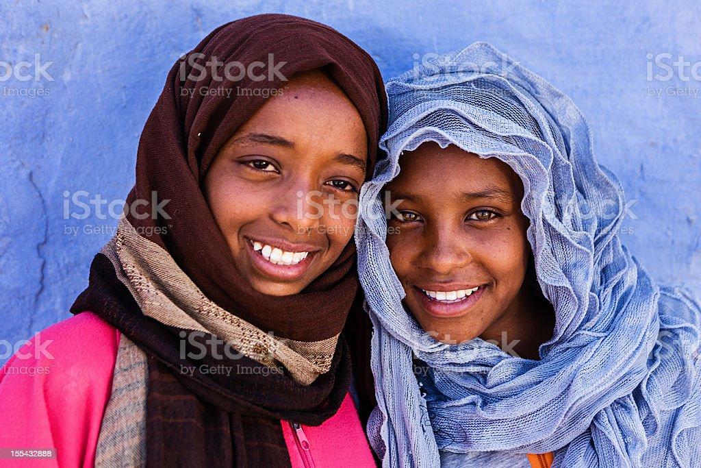Two beautiful Muslim girls in Southern Egypt stock photo