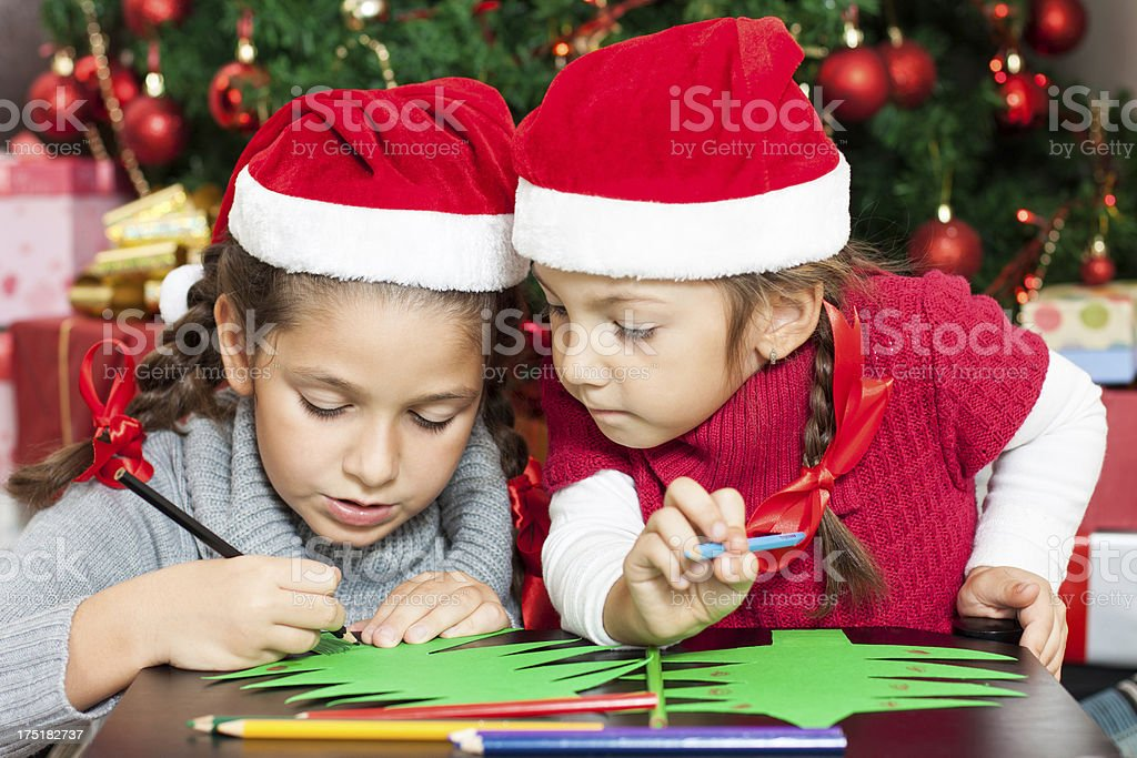 Two Beautiful Sisters making Christmas cards stock photo