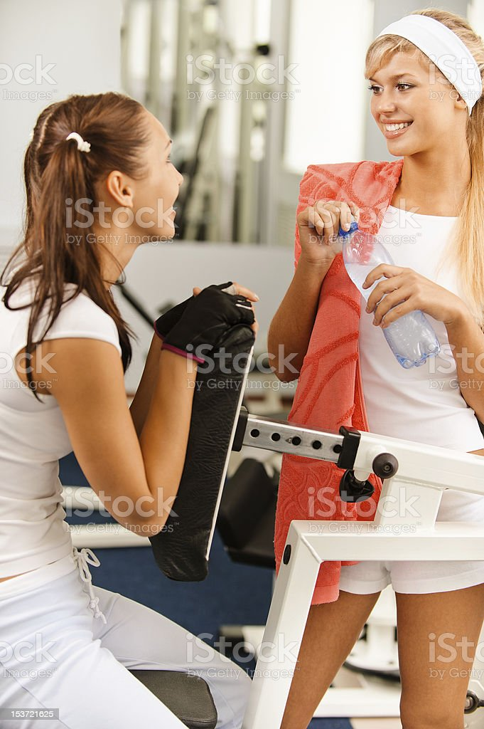 Two beautiful sportwomen make exercise royalty-free stock photo