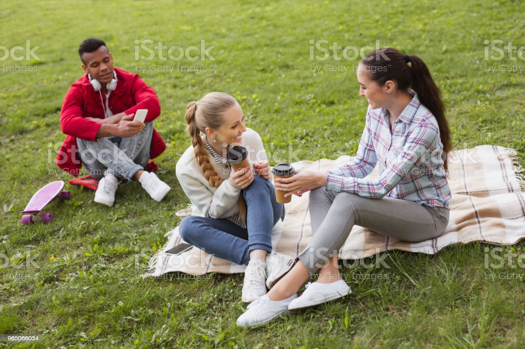 Two beautiful students laughing during coffee break royalty-free stock photo