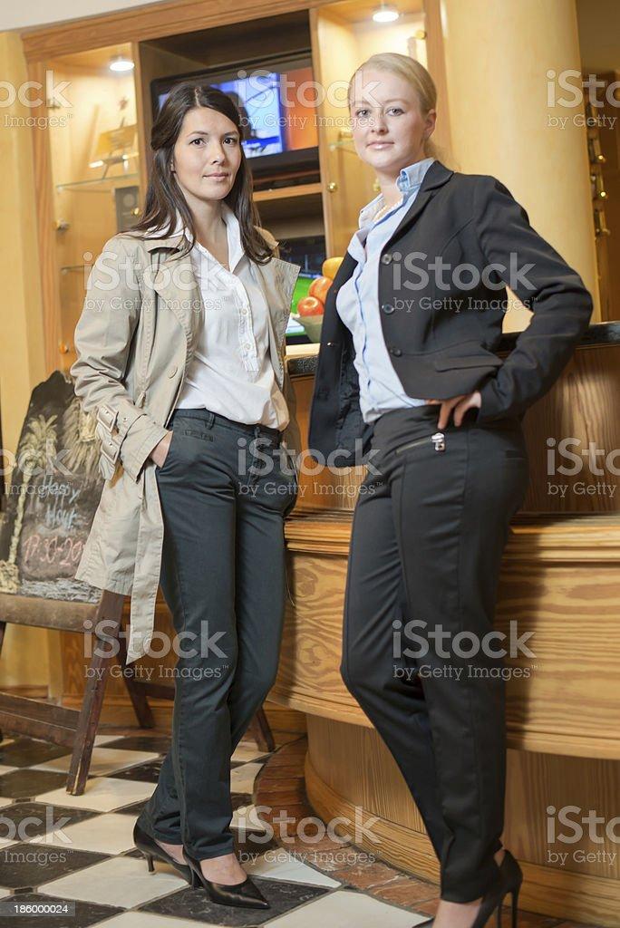 Two beautiful stylish women royalty-free stock photo