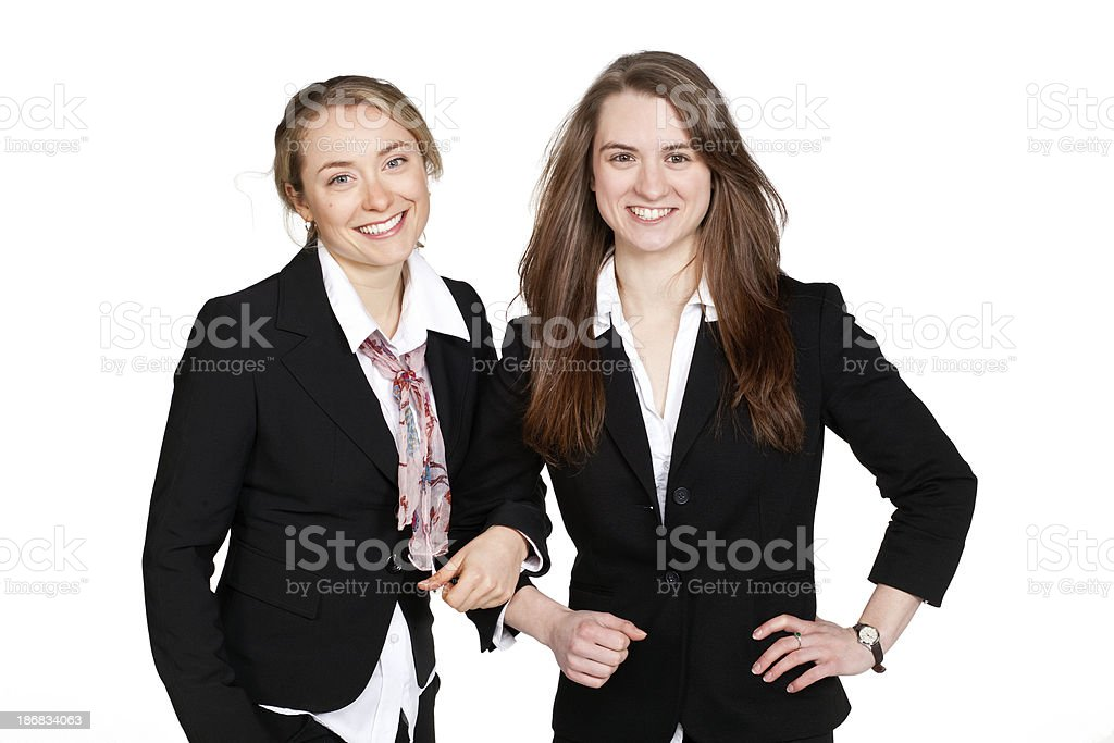 Two beautiful well dressed young women on a white background stock photo