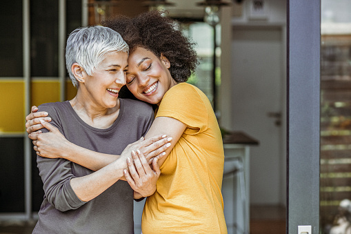 Two Beautiful Woman Embracing Stock Photo - Download Image Now