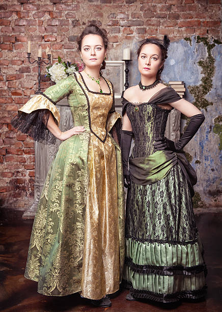 two beautiful women in medieval dresses - petticoat stock pictures, royalty-free photos & images