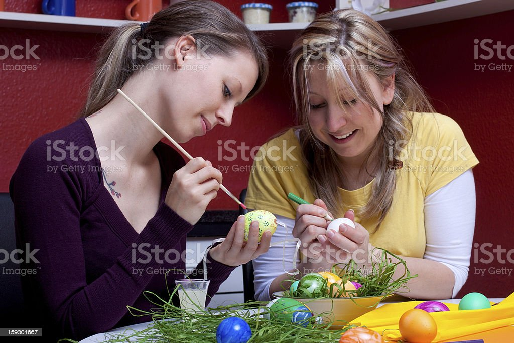 two beautiful women painted Easter eggs royalty-free stock photo
