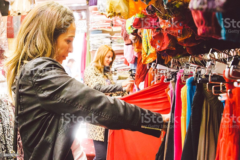 Two Beautiful Women Shopping Traditional Clothes stock photo