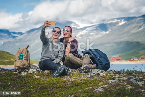 Two beautiful young girlfriends travel together in Norway, adventure, hiking, lifestyle concept
