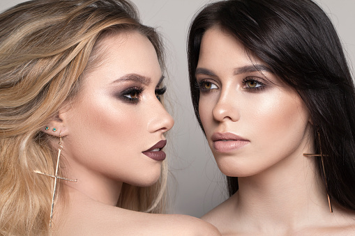 two beauty girls with professional make up and beautiful hair portrait