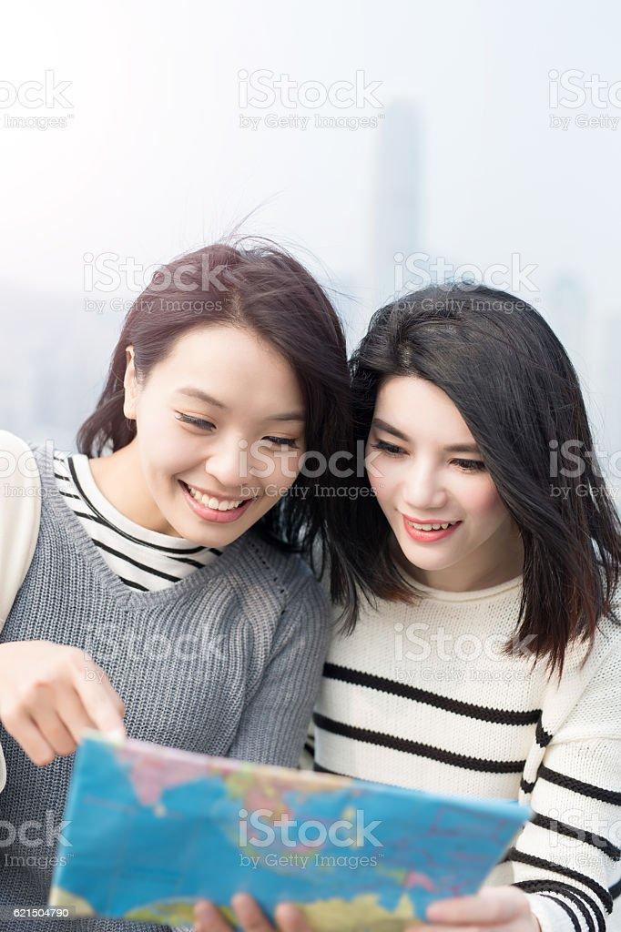 two beauty woman look map Lizenzfreies stock-foto