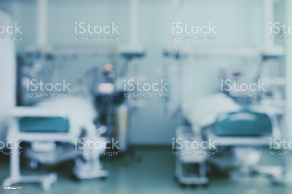 Two beds in intensive care unit, blurred background stock photo