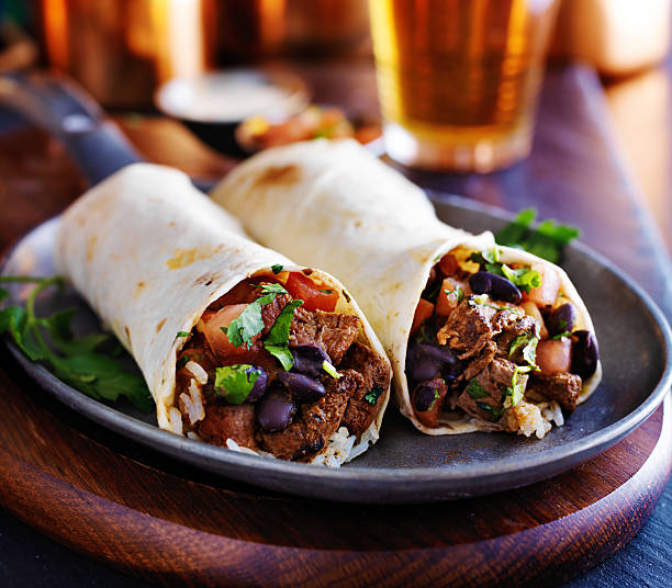 two beef steak burritos - mexican food stock photos and pictures