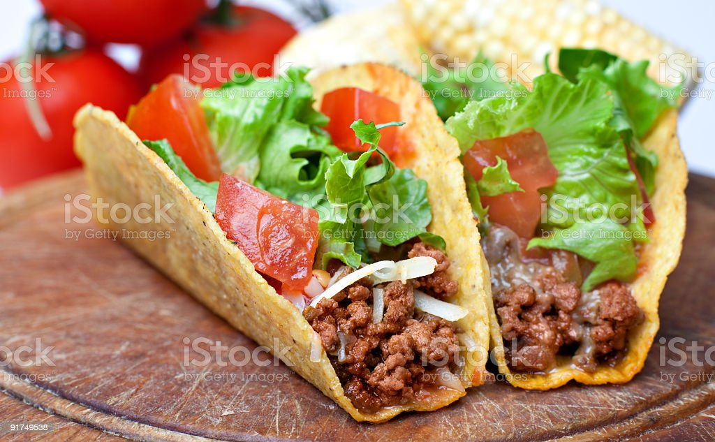 Two beef tacos on a cutting board royalty-free stock photo