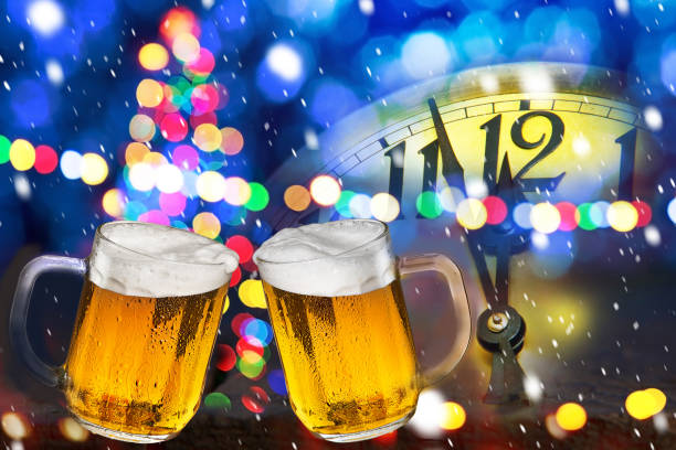 Two beers. Celebratory drink on the new year eve. stock photo