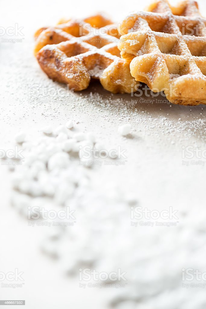 Two Belgium Liege Waffles with Sprinkled Icing Sugar and Pearls stock photo