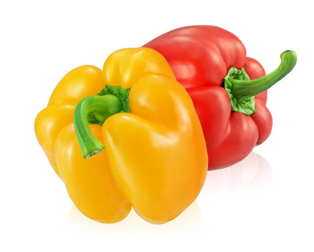 Two bell peppers isolated on white background. Fresh sweet yellow and red bell peppers isolated on white background. yellow bell pepper stock pictures, royalty-free photos & images