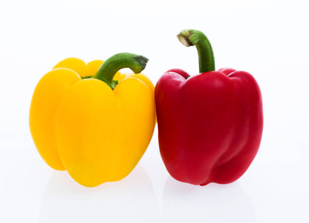 Two bell peppers on white background Two bell peppers on white background. yellow bell pepper stock pictures, royalty-free photos & images