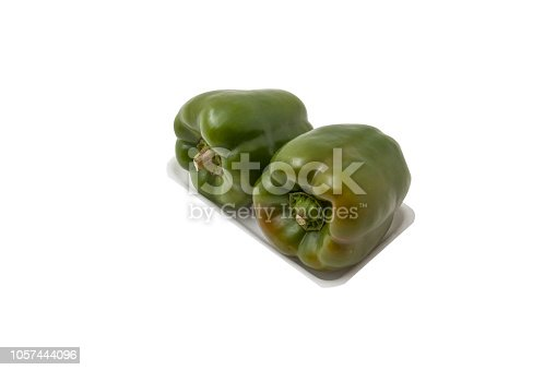 Two bell peppers on white background