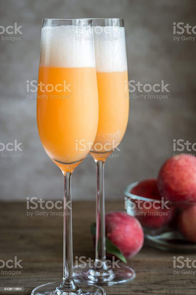 Two bellini cocktails with fresh peaches stock photo