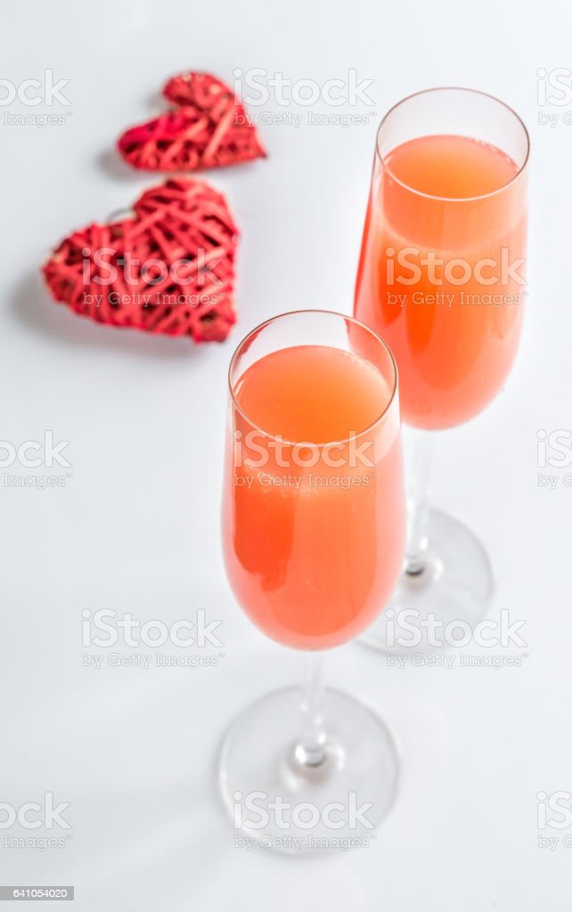 Two bellini cocktails with hearts stock photo