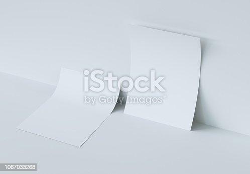 istock Two bending Paper Mockup. 3d rendering. 1067033268
