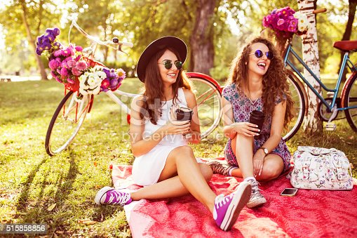 istock Two best friends drinking coffee to go in nature 515858856
