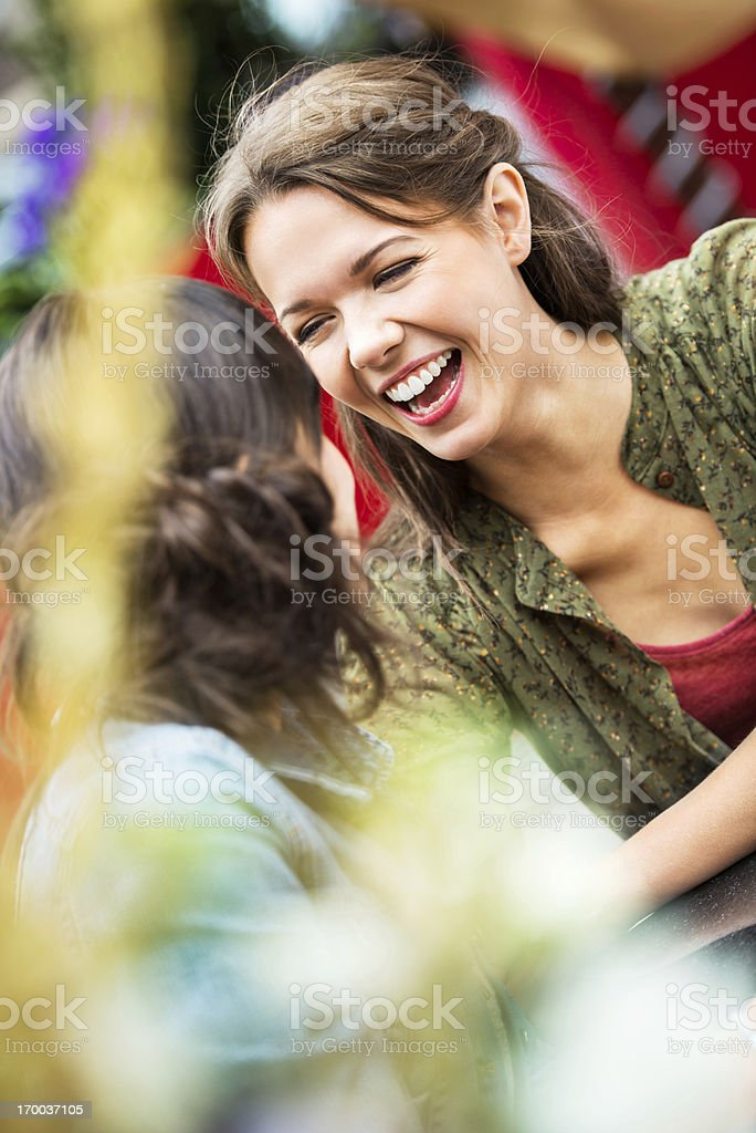 Two best friends sitting in a cafe and talking. royalty-free stock photo
