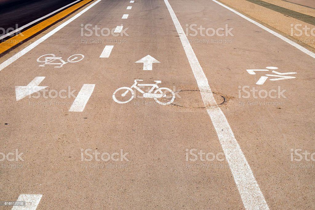 Two Bicycle Lanes and a Runners Lane beside the Highway stock photo