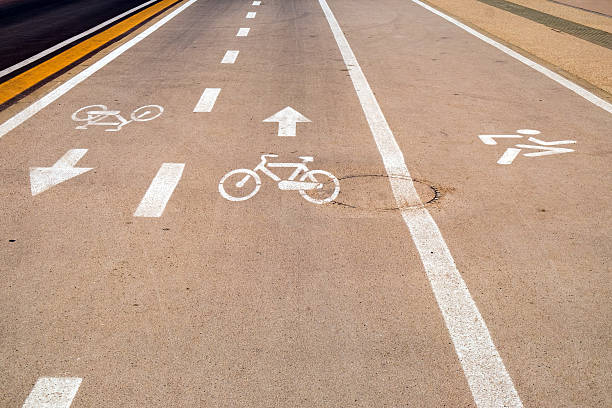 two bicycle lanes and a runners lane beside the highway - dotted line stock photos and pictures