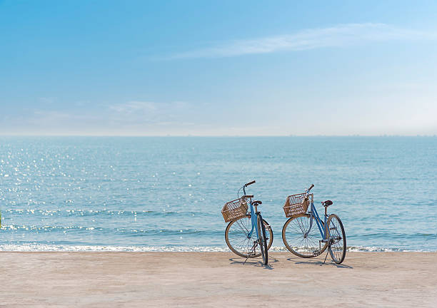 Two bicycle on the seaside stock photo