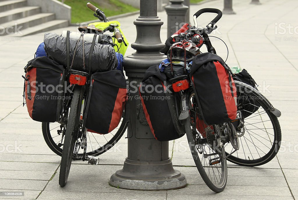 Two bicycles parked along a city sidewalk stock photo