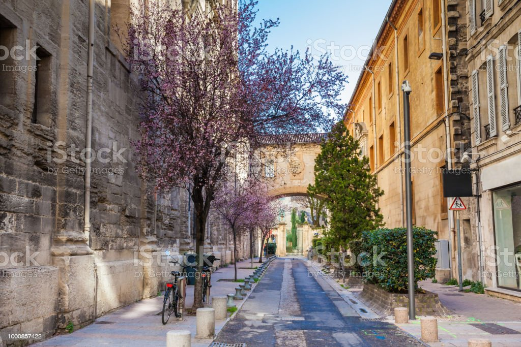 Two bicycles parked on the Rue Frederic Mistral at the walled city of Avignon - Royalty-free Ancient Stock Photo