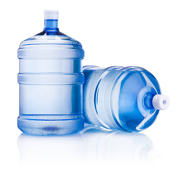 Two big bottle of water isolated on white background Two big bottle of water isolated on a white background gallon stock pictures, royalty-free photos & images