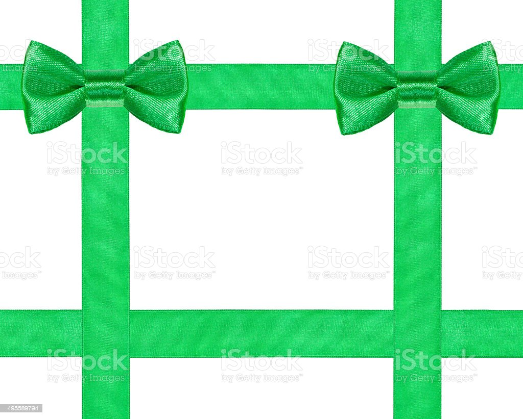 two big green bow knots on four satin ribbons stock photo