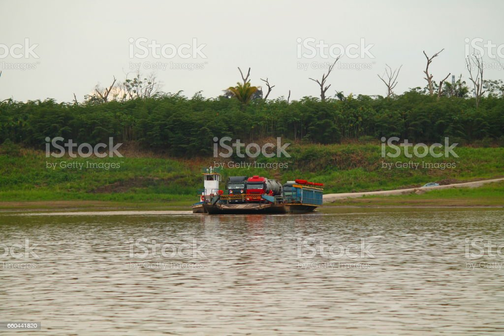 two big trucks on a ferry in the brazilian jungle stock photo