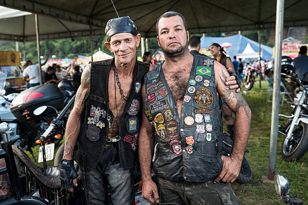 two bikers at motorcycle festival, rio de janeiro state, brazil - böse tattoos stock-fotos und bilder