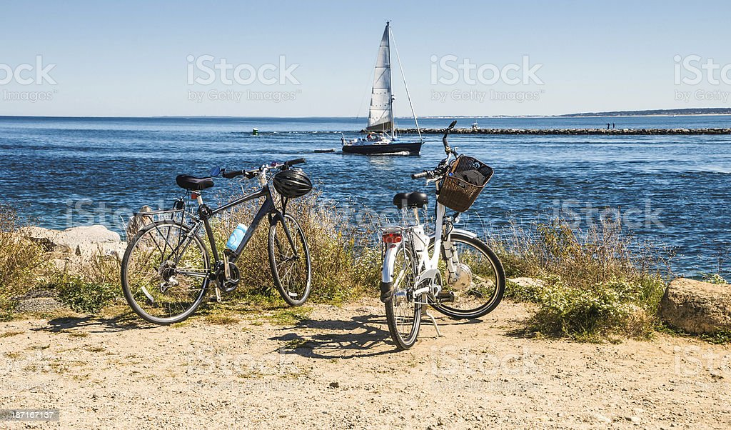 Two Bikes and a Boat stock photo