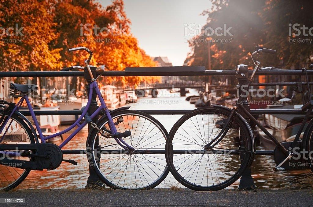 Two bikes on a bridge in Amsterdam royalty-free stock photo