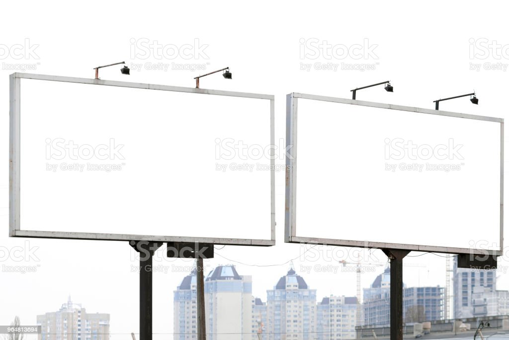 Two billboards against cloudy cityscape. royalty-free stock photo